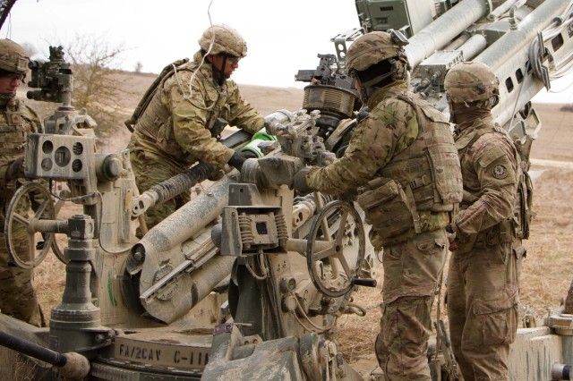 Spc. Christopher Rios (center), #2 man for the gun crew of 1st Section, 1st Platoon, Cobra Battery, Field Artillery Squadron, 2d Cavalry Regiment, U.S. Army, places the powder charge into a M777A2 Howitzer during a fire mission March 8, 2017 in the Grafenwoehr Training Area, Germany. The Squadron participated in Dynamic Front II March 6-9, 2017. The exercise enabled the U.S., Germany and Czech Republic together to synchronize their artillery capabilities.