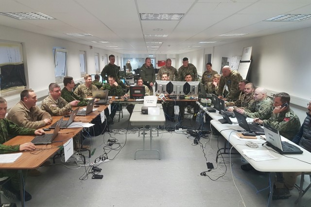 Soldiers of the 2500th and 250th Digital Liaison Detachments work with NATO allies March 10 during the multinational exercise Dynamic Front II in their Tactical Operations Center at Grafenwoehr, Germany. (Photo courtesy 2500th Digital Liaison Detachment)