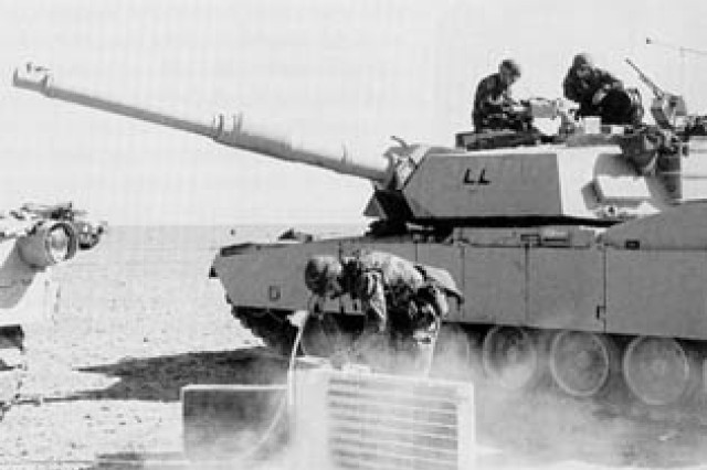 3d Armored Division troops combat the ubiquitous desert dust by performing daily maintenance on their M1A1s.