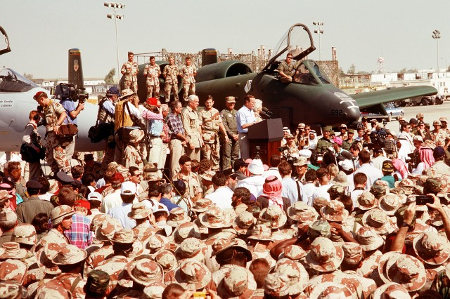 Then President George Bush speaks to U.S. Military personnel gathered for his Thanksgiving holiday visit during Operation Desert Storm in Saudi Arabia, Nov. 22, 1990.