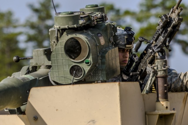 A Soldier with the 27th Infantry Brigade Combat Team defends the fictional town of Dara Lam at the Joint Readiness Training Center, Ft. Polk, La., July 23, 2016.