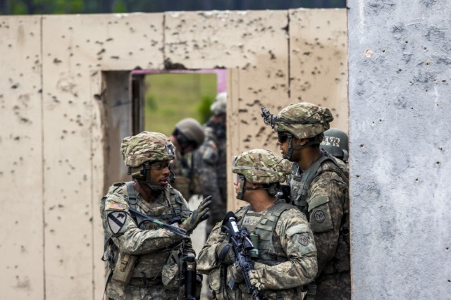 New York Army National Guard infantrymen assigned to Co. C, 1st Battalion, 69th Infantry Regiment, based in New York City, assault Objective Tarantula during a live fire training exercise at the Joint Readiness Training Center, Ft. Polk, La., July 25, 2016.