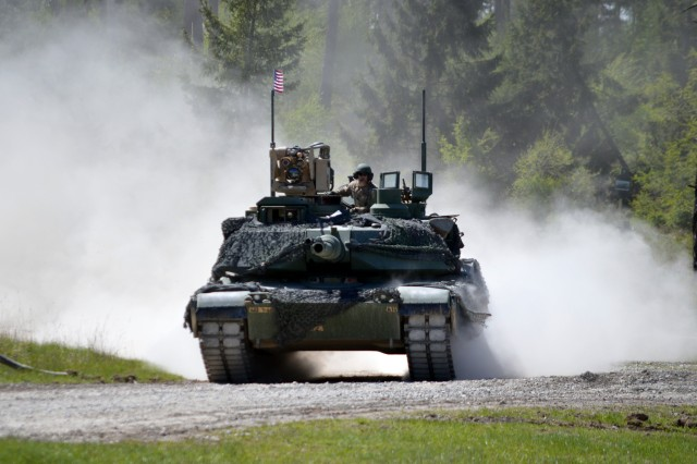 """Team United States, from 1st Battalion 66th Armor Regiment """"Iron Knights"""", 3rd Brigade Combat Team, 4th Infantry Division (Iron Brigade) maneuvers the vehicle identification lane during the Strong Europe Tank Challenge at the 7th Army Training Command's Grafenwoehr Training Area, Germany, May 11, 2017."""