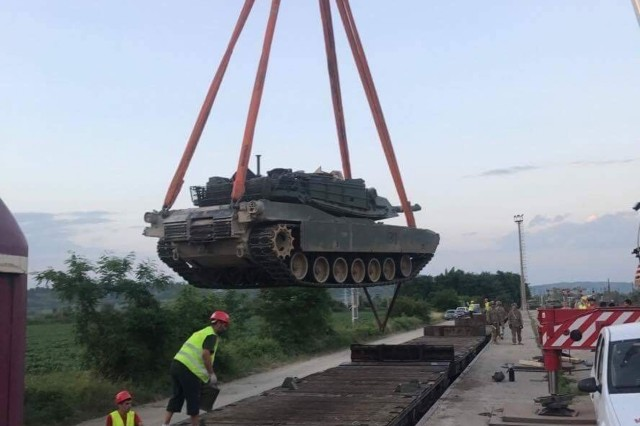 An M1A2 Abrams tank is lifted from a rail car during rail operations at Voila, Romania, June 30, 2017, prior to movement to the Cincu Joint Multinational Training Center in Cincu, Romania, where the brigade will participate in the U.S. Army Europe-led multinational exercise Getica Saber 17. Getica Saber is a U.S.-led fire coordination exercise and combined-arms live fire exercise being held from July 8-15 to highlight participant deterrence capabilities, specifically the ability to mass forces at any given time anywhere in Europe. Besides the 3rd ABCT, 4th Inf. Div., Getica Saber will feature the Romanian 282nd Mechanized Brigade, the U.S. 1st Cavalry Division Artillery and service members from Croatia, Ukraine, Portugal, Montenegro and Armenia.. (U.S. Army photo by Staff Sgt. Marcus Montgomery, 3rd Armored Brigade Combat Team, 4th Infantry Division)