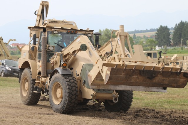 A Soldier of 588th Brigade Engineer Battalion, 3rd Armored Brigade Combat Team, 4th Infantry Division, uses a front-end loader to clear debris and smooth a road for tactical vehicles participating in the U.S. Army Europe-led multinational exercise Getica Saber 17 at the Cincu Joint Multinational Training Center in Cincu, Romania, July 1, 2017. Getica Saber is a U.S.-led fire coordination exercise and combined-arms live fire exercise being held from July 8-15 to highlight participant deterrence capabilities, specifically the ability to mass forces at any given time anywhere in Europe. Besides the 3rd ABCT, 4th Inf. Div., Getica Saber will feature the Romanian 282nd Mechanized Brigade, the U.S. 1st Cavalry Division Artillery and service members from Croatia, Ukraine, Portugal, Montenegro and Armenia. (U.S. Army photo by Staff Sgt. Ange Desinor, 3rd Armored Brigade Combat Team, 4th Infantry Division Public Affairs)