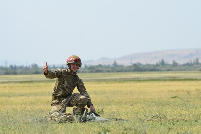 VAZIANI TRAINING AREA, Georgia - A British Soldier, Pvt. Christopher Kantorowicz, 2nd Battalion, Parachute Regiment (2nd PARA), 16th Air Assault Brigade, Essex, England, gives a thumb up for a good jump, at the drop zone on Vaziani Training Area, Georgia, Aug. 7, 2017. The red tape signifies first-time jumpers. The 2nd PARA is currently in the Republic of Georgia to participate in Exercise Noble Partner. Noble Partner is a multinational, U.S. Army Europe-led exercise conducting home station training for the Georgian light infantry company designated for the NATO Response Force. (U.S. Army photo by Sgt. Shiloh Capers)