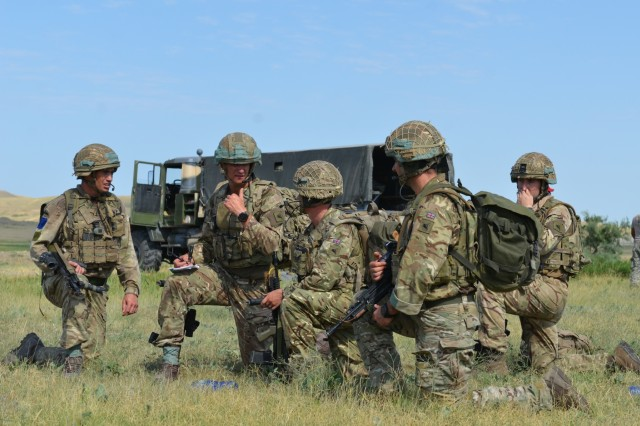 VAZIANI TRAINING AREA, Georgia - British officers and leaders of the 2nd Battalion, Parachute Regiment (2nd PARA), 16th Air Assault Brigade, Essex, England, rally at the collection point after jumping into the drop zone on Vaziani Training Area, Georgia, Aug. 7, 2017. The 2nd PARA is currently in the Republic of Georgia to participate in Exercise Noble Partner. Noble Partner is a multinational, U.S. Army Europe-led exercise conducting home station training for the Georgian light infantry company designated for the NATO Response Force. (U.S. Army photo by Sgt. Shiloh Capers)