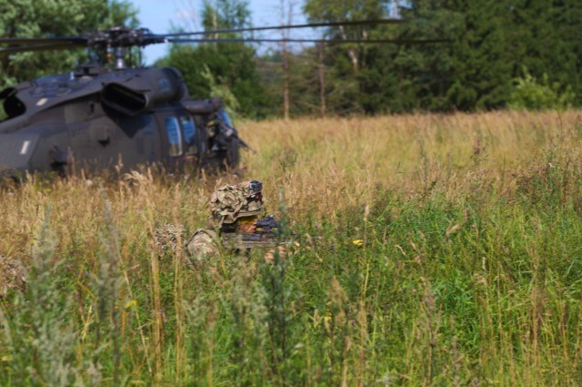 A British Army soldier with the 5th Battalion, The Rifles, 20th Armored Brigade, pulls security in front of a UH-60L Black Hawk during a training exercise at Saase, Estonia on August 9, 2017. The 5th Battalion, The Rifles, 20th Armored Brigade is currently working in Estonia as a part of Operation Atlantic Resolve, which is a NATO mission involving the US and Allied and partnered nations in Europe in an effort to enhance regional stability and to deter aggression. (Photo by Army Pfc. Nicholas Vidro, 7th Mobile Public Affairs Detachment)