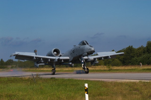 """A US Army A-10 Thunderbolt II """"Warthog"""" belonging to the 175th Wing, Maryland Air National Guard, lands on a stretch of highway during an exercise near Jagala, Estonia on August 10, 2017. The exercise was a chance for the public to see NATO forces working together as a part of Operation Atlantic Resolve, which is a NATO mission involving the US and Europe in a combined effort to strengthen bonds of friendship and to promote peace. (Photo taken by Pfc. Nicholas Vidro, 7th Mobile Public Affairs Detachment.)"""