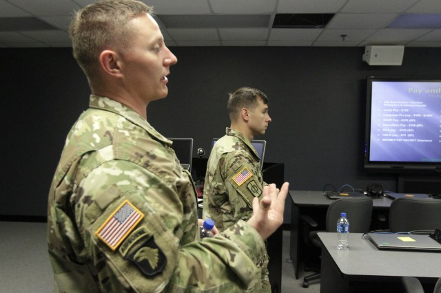 Sgt. 1st Class Kiel Mulhern (front) and Staff Sgt. Zachary Wangerin give a presentation on the Army Special Operations Forces at the Graham Resiliency Training Center at Fort Sill, Okla., Aug. 3, 2017. They were recruiting enlisted and officers of both genders who meet the criteria.