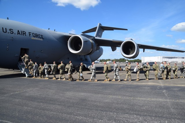 Members of the 252nd Military Police Co., 117th MP Battalion, Tenn. Army National Guard climb aboard a Tenn. Air Guard C-17 Globemaster out of the 164th Airlift Wing, based in Memphis, Tenn., bound for the US Virgin Islands.  The 252nd MP Co. assisted local authorities in the U.S. Virgin Islands with various tasks such as point of distribution security and traffic control along major roadways.