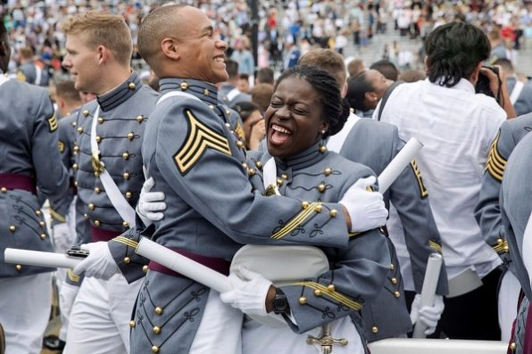 West Point cadets hug each other at the end of graduation ceremonies at the United States Military Academy, Saturday, May 25, 2019, in West Point, N.Y. (Julius Constantine Motal/AP)