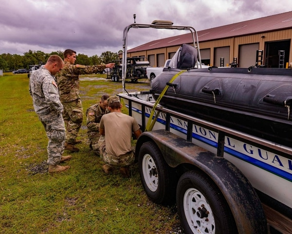 Members of the Florida National Guard chemical, biological, radiological and nuclear defense (CBRN) Enhanced Response Force Package prepare to help citizens in affected areas prior to landfall of Hurricane Michael at Camp Blanding Joint Training Center near Starke, Fla., on Oct. 9, 2018. (Charles Oettel/Florida National Guard)