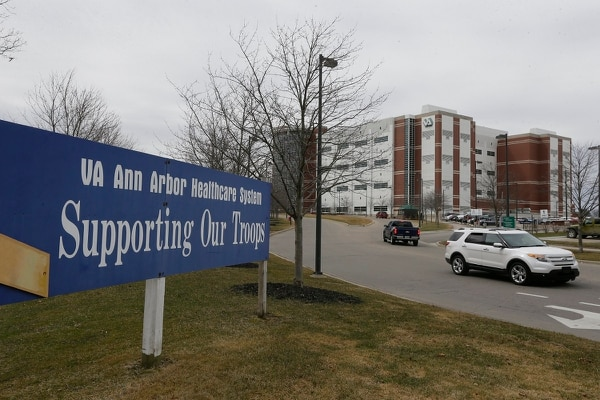 The VA Ann Arbor Healthcare System in Michigan is shown in April 2015. Long wait times at VA facilities prompted an increase in veterans medical appointments outside department facilities, which has prompted accusations of privatization of VA services. (Carlos Osorio/AP)