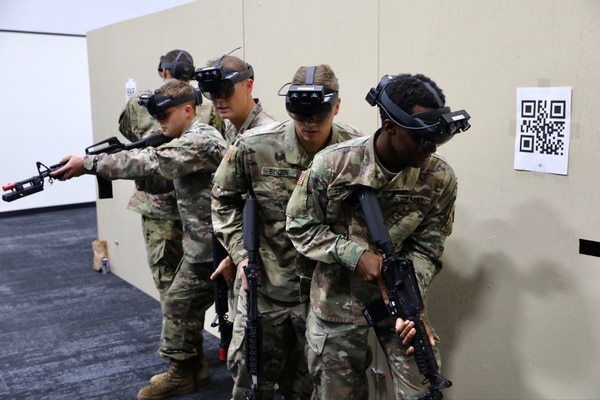 Soldiers from the 3rd Infantry Division don the Integrated Visual Augmentation System during their training with the Squad Immersive Virtual Trainer in the Soldier Integration Facility at Fort Belvoir, Va., on Aug. 14, 2020. (Army)