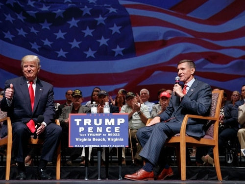 Then-presidential candidate Donald Trump gives a thumbs up as he speaks with retired Lt. Gen. Michael Flynn during a town hall, Tuesday, Sept. 6, 2016, in Virginia Beach, Va. (AP Photo/Evan Vucci, file)