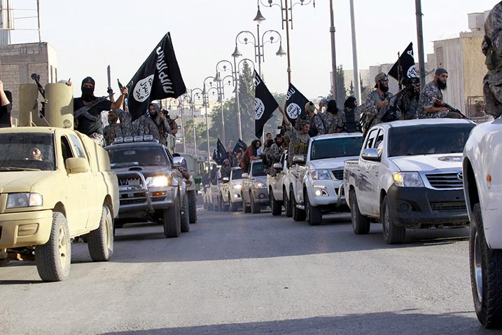 Militant Islamist fighters parade 30 June 2014 in the streets of northern Raqqa Province, Syria