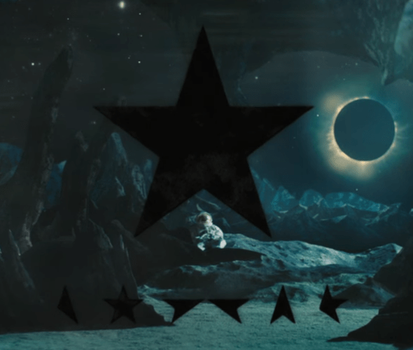 A black star and star glyphs are featured with the dead astronaut and eclipsed star.