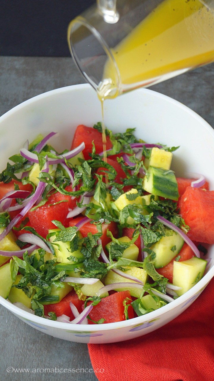 Pour the dressing over the watermelon salad