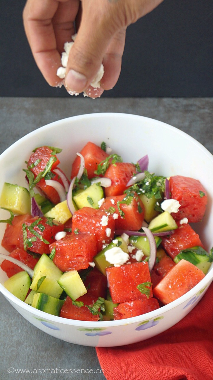 Sprinklethe salad with crumbled feta cheese