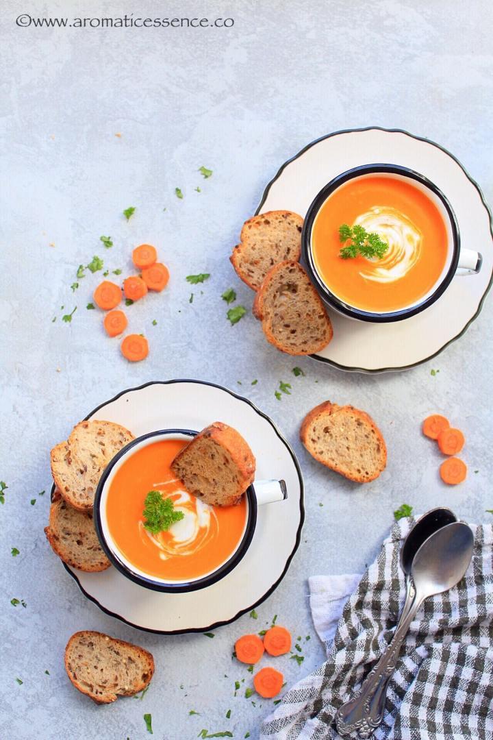 Overhead shot of pressure cooker carrot ginger soup in white enamel mugs