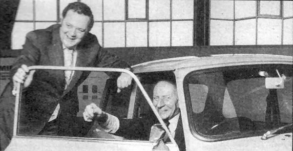 Alec Issigonis and Austin Morris Managing Director, Keith Hopkins, commemorate the Mini being the best- selling car in the UK in February 1975.
