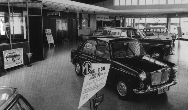 A Dominion Motors showroom, circa 1964. An MG 1100 steals the limelight in this shot, although another ADO16 (possibly a Morris 1100) can be seen tucked away in the background.