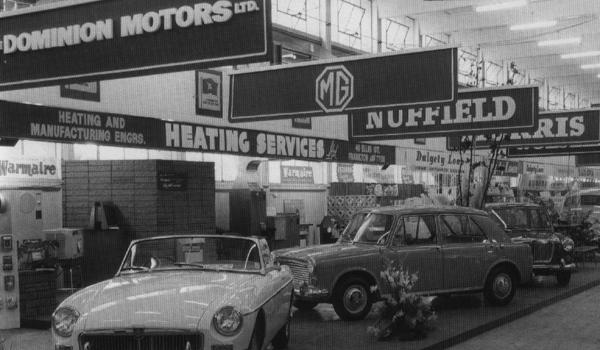 This New Zealand trade fair stand has a clear ADO16 bias, with Morris and MG 1100s keeping the MGB company beneath the MG, Nuffield, Morris and Wolseley banners of Dominion Motors Ltd. Dominion also handled the Riley franchise, of course.