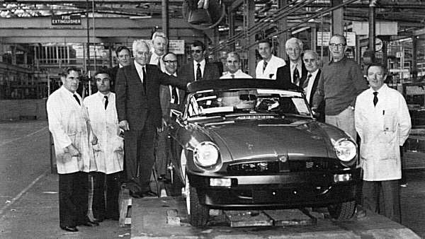 A sad day: The 23rd October 1980 and the last MGB roadster comes off the production line. Flanking the car are on the left Syd Enever and John Thornley.
