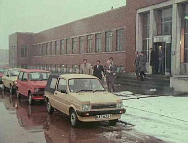 BL's top brass go for a ride and drive around Longbridge. Here they are seen emerging from the Kremlin, and are about to hop into an LC8 and an ADO88 - a Volkswagen Polo and Morris Ital (out of shot to the rear) have been brought along for comparison... (Picture: BMIHT)