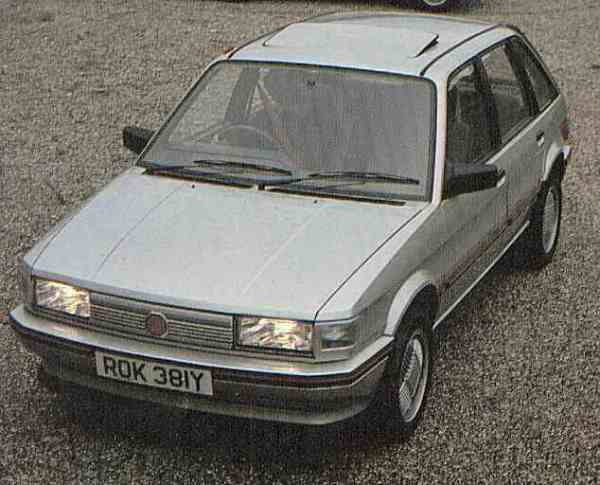 Hastily developed and half cooked is a rather honest description of the MG Maestro 1600. In order to extract a competitive power output from the R-Series engine (up from 81bhp to 103bhp), the single electronically controlled SU carburettor was replaced by a throaty twin Weber set-up. The induction noise of this car sounded terrific, but the downside was the well-documented problem of excessive heat build-up under the bonnet leading to fuel starvation and hot-starting problems. Also, customers did not take too well to the solid state instrument pack, shared with the Vanden Plas version. Nevertheless, there were many appealing aspects to the package: the accomodation, like all Maestros was generous and airy, the seats were exceptionally comfortable and performance was on the rapid side of acceptable.