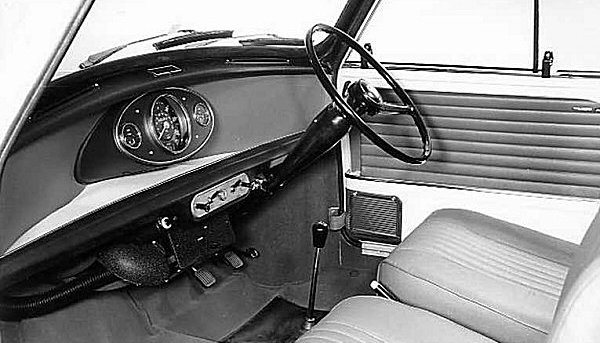 Mini development story: Minimalist interior: although this is a 1967 Morris Mini-Cooper 'S' MkII, it is still an extremely functional design. This Mini received a remote gearchange and more comprehensive instrumentation over the original. Note the sliding windows and huge door-bins - made obsolete a year later by the later wind-up- windows Minis (known as the ADO20).