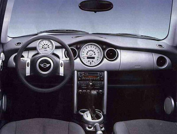 Interior is generally regarded to be the new MINI's finest asset: quality is good and the style is very retro, featuring a centrally mounted speedometer and pod-mounted tachometer. This design was inspired by the interior of the ACV30 and finalised by Britons Wynn Thomas and Tony Hunter.