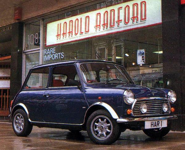 The latter-day Radford Mini de Ville S, wearing the same numberplate as Harold Radford's early Countryman demonstrators, is seen here in 1995 posing outside Radford's George Street showrooms (formerly home to the UK's Lamborghini importer and now the premises of Italian car dealership Lancia Zagato).