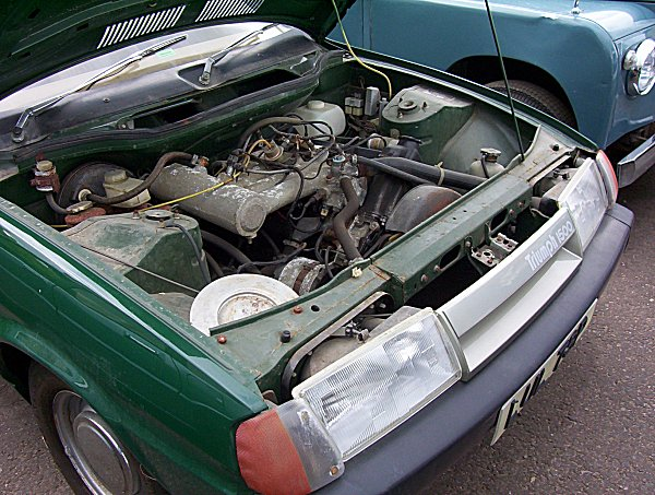 Triumph engine looks lost under the bonnet: prototype uses fuel-injected version of the 16V slant-four found in the Sprint