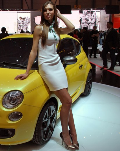Yellow Zagato-Fiat, beige dress, gold heels. Fantastic.