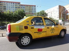 Dacia Logan Taxi - note the fares on the passenger door