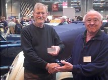 Alan Firth (left) receives the Compliance plate for his P76 from Lyn Thomas, on the RSR stand at the 2011 NEC Classic Car Show