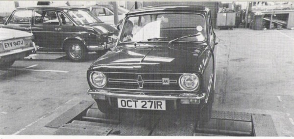 Mini Clubman on the rolling road. Note Wolesley Landcrab in the background.
