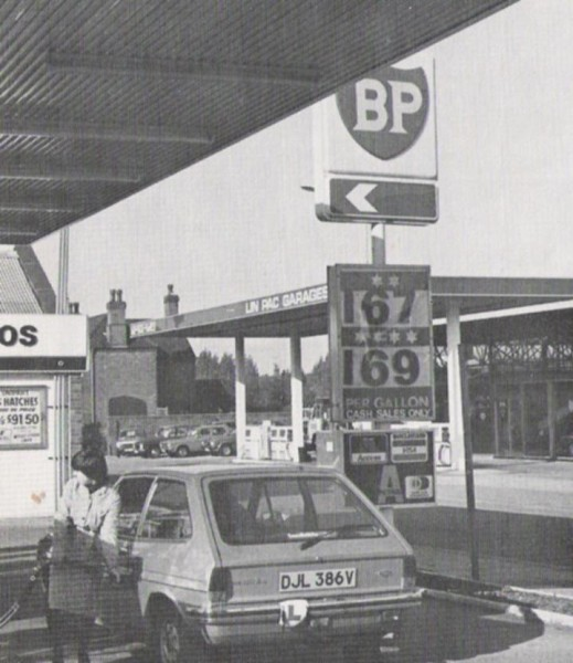 Locally registered Fiesta gets filled up. Lin Pac, the Toyota dealership in the background still exists today as a Toyota dealership but has changed hands and lost the Petrol station.