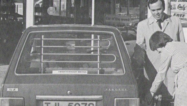 """Holland Brothers' pump attendant fills up another locally registered car, this time TJL 507S, a humble Pug 104. The owner's smiling but sounds less than satisfied with his purchase if his """"Wish I'd bought British"""" sticker is anything to go by…"""