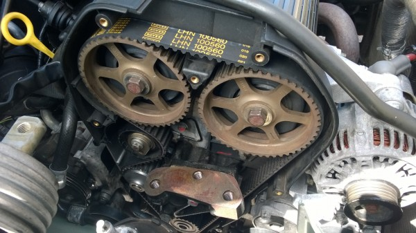 After being half roasted in the sun, the new pump and timing belt were fitted - Original parts too just for the record!