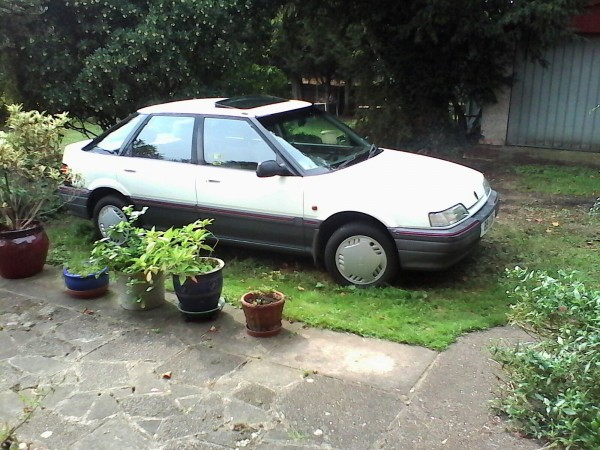 Clean, low mileage original Ronda cosies up to some flower tubs. We must be in 1990s suburbia...