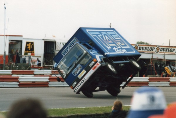 Gilbert Bataille, the Belgian stunt driver does his party trick by completing a full lap of the Silverstone circuit