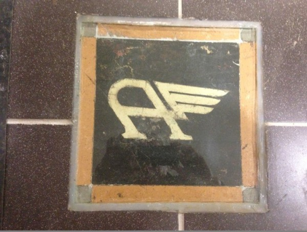 An Austin 'Flying A' tile is still embedded in the showroom wall