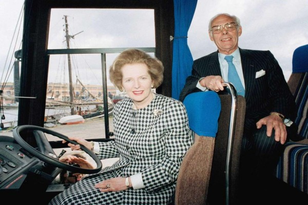 """Maggie and Denis were used to travelling by coach. Here they sit at the wheel of her other """"Battle Bus"""" - A Leyland Tiger. Image: Associated Press"""