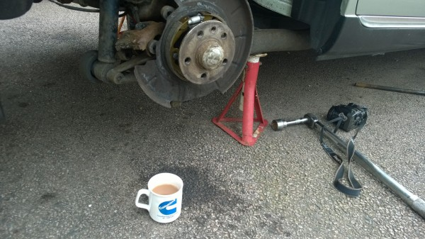 It looks and is a little fiddly but its really simple to adjust the handbrake on a 75. The silver adjuster cog can be seen at the top of the backplate and is operated by poking and flicking a slim flat screwdriver through a stud hole with the disc in situ.