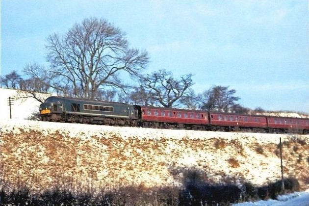 D22 with an afternoon train on the Waverley route photographed approximately two miles south of Hawick in the snows of 1967.