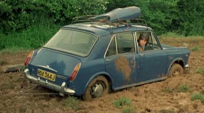…the Morris gets stuck in the mud, and Stimpson tries to extract it by a) pushing it for all he's worth, b) kicking it in the rear door, and c) giving up to find a tractor. Sadly, instead of a tractor, he finds a… monastery.