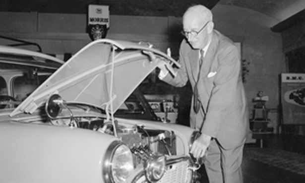 sir-leonard-lord-inspects-the-engine-of-the-austin-seven-car-218994960